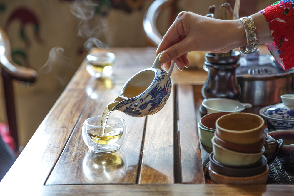 Chinese Tea Ceremony - tea being poured from blue and white tea ware